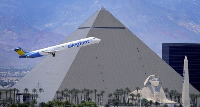In this 2013 photo, an Allegiant Air jetliner flies by the Luxor Resort & Casino after takeoff. An Allegiant Air spokesperson says there has been a 4.5 per cent increase in Canadian flyers this year across the board, including out of the Minot terminal, the airline's closest centre to Brandon.