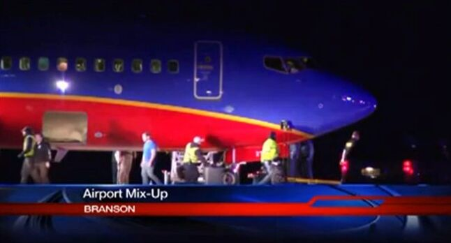 This frame grab provided by KSPR-TV shows a Southwest Airlines flight that was scheduled to arrive Sunday Jan. 12, 2014, at Branson Airport in southwest Missouri instead landed at an airport 7 miles north — with a runway about half the size of the intended destination. (AP Photo/KSPR-TV)