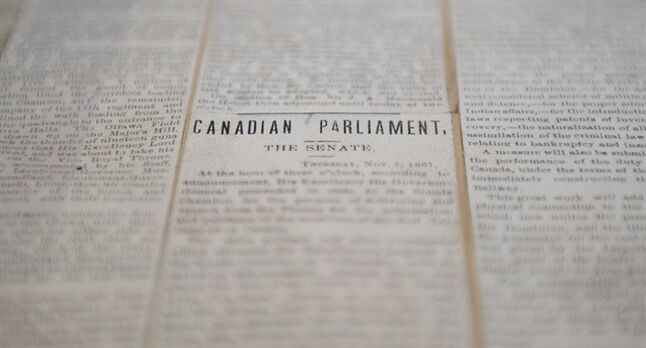A scapbook of early newspaper clippings offers a glimpse of the daily events and debates in Canadian Parliament on display in the Library of Parliament on Parliament Hill Tuesday May 27, 2014 in Ottawa. THE CANADIAN PRESS/Adrian Wyld