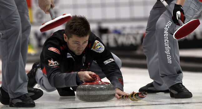Mike McEwen delivers a stone during Thursday's action at the provincial men's curling championship.