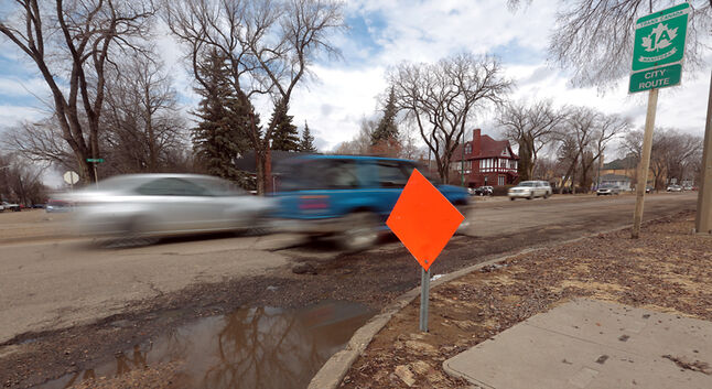 Traffic travels eastbound on Thursday afternoon past a caution sign along Victoria Avenue, which ranks as the eighth-worst road in the province, according to a CAA Manitoba poll of motorists. At least that's better than last year, when it was deemed the province's worst road.