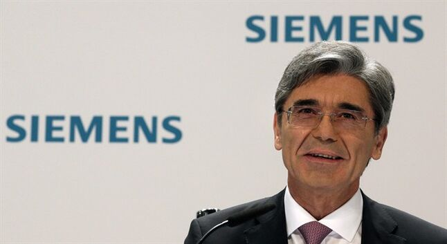President and CEO of Siemens, Joe Kaeser speaks during the company's joint semiannual press and analyst conference in Berlin, Germany, Wednesday, May 7, 2014. Kaeser is eliminating the sprawling company's four broad sectors overseeing its businesses, and will trim those business divisions from 16 to nine. Each division will get a profit margin target as Siemens aims to focus on fields where it can grow and earn the most. (AP Photo/Michael Sohn)