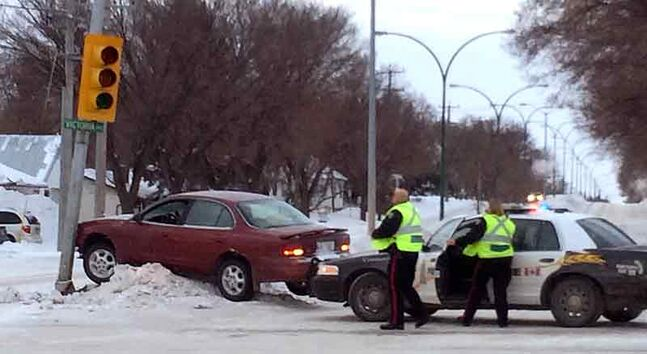 Brandon police attend to an apparent single-vehicle crash at 26th Street and Victoria Avenue just before 9 a.m. Tuesday. There was no immediate word on injuries.