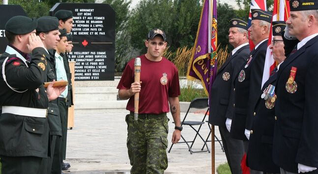 A soldier from CFB Shilo carries the baton after a ceremony marking the Second Battalion, Princess Patricia's Canadian Light Infantry, 100 years of service to Canada. The ceremony was outside of Brandon Armoury yesterday.