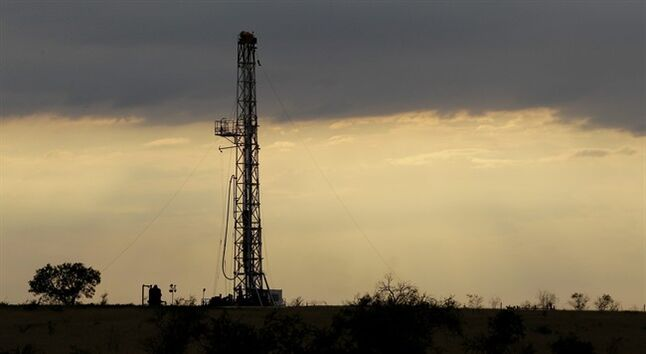 FILE - This May 9, 2012 file photo shows a drilling rig near Kennedy, Texas. Oil companies are finding new ways to export growing amounts of oil from the U.S. despite restrictions on exporting crude.(AP Photo/Eric Gay, File)