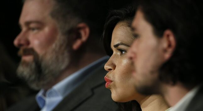 Actress America Ferrera, center, listens to questions during a press conference for How to Train Your Dragon 2 at the 67th international film festival, Cannes, southern France, Friday, May 16, 2014. (AP Photo/Alastair Grant)