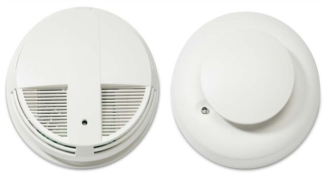 This undated combo image made from images provided by the U.S. Consumer Product Safety Commission shows an ESL and Interlogix smoke detector 400 series, left, and an ESL and Interlogix smoke detector 500 series. Radio frequency interference can cause the smoke detectors to fail to alert consumers of a fire. (AP Photo/U.S. Consumer Product Safety Commission)