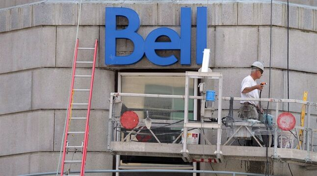 A construction worker works on a Bell building in Ottawa on June 26, 2013. THE CANADIAN PRESS/Sean Kilpatrick