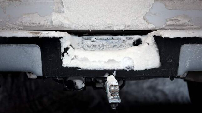 This snow-covered licence plate could cost the motorist $203.80. Police say it hinders enforcement.