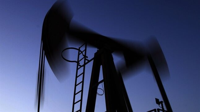 An oil pump works at sunset March 7, 2013, in the desert oil fields of Sakhir, Bahrain. THE CANADIAN PRESS/AP, Hasan Jamali
