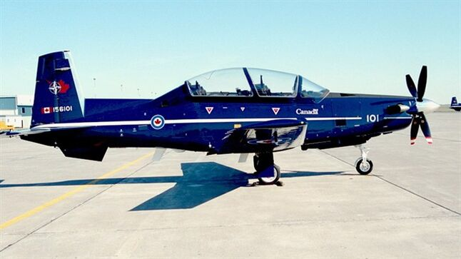 A CT- 156 Harvard II trainer aircraft sits on the tarmac at CFB Moose Jaw, Saskatchewan on March 15, 2006. A military plane has gone down near a Canadian Forces Base south of Moose Jaw, Sask. Officials at 15 Wing say two people in the Harvard training aircraft walked away unharmed after what is being called a — quote —