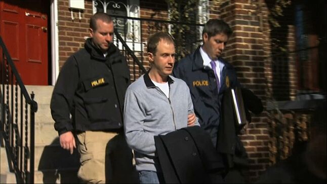 This Dec. 11, 2013 image from video provided by WJLA-TV, shows Ryan Loskarn, former chief of staff to Sen. Lamar Alexander, R-Tenn., being escorted from his Washington home by U.S. Postal Inspector police. Loskarn has been found dead in Maryland, just weeks after the former staffer's arrest on child pornography charges. The Carroll County Sheriff's office said on its website Friday that Ryan Loskarn was found dead Thursday in Sykesville, Md. Deputies say the preliminary investigation shows Loskarn may have committed suicide. (AP Photo/WJLA-TV)