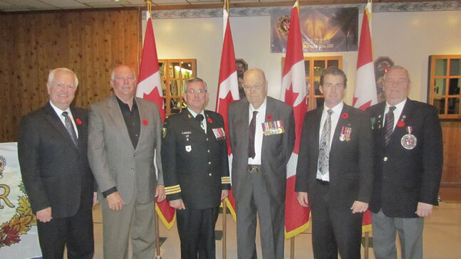 Photo (L-R) MP Merv Tweed, Bernie Chrisp, Rick Felstead, A.R. Neale, Glen Kirkland, Murray McQuiston. Diamond Jubilee medal recipients today in Brandon.