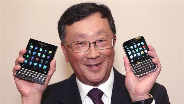 BlackBerry CEO John Chen shows off the new Passport (left) and Classic phone models after the company's Annual General Meeting in Waterloo, Ont., Thursday June 19, 2014. THE CANADIAN PRESS/Dave Chidley