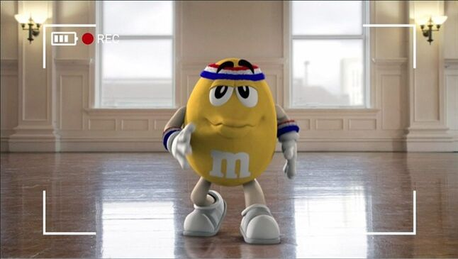 "This image provided by Mars Inc. shows an online teaser ad for M&M's Super Bowl ad featuring its yellow peanut M&M ""spokescandy"". The teaser is part of a Super Bowl ad trend: More content is being released ahead of time online in the hope that it goes viral. Advertisers are seeking to drum up excitement for their spots running during the big game, when more than 108 million people are expected to watching Feb. 2. (AP Photo/Mars Inc.)"