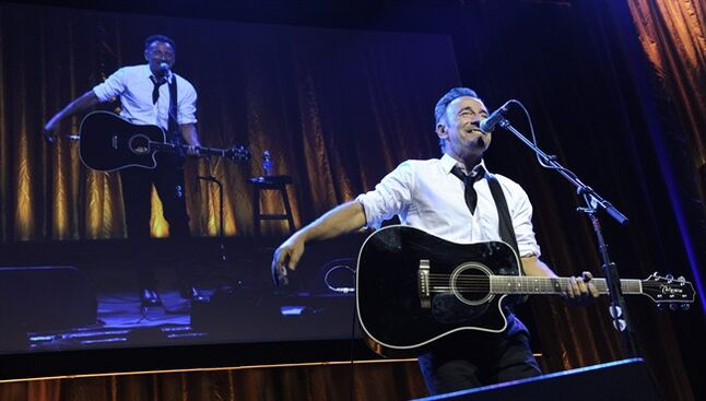 Bruce Springsteen performs during the USC Shoah Foundation's 20th anniversary Ambassadors for Humanity gala in Los Angeles, Wednesday, May 7, 2014. (AP Photo/Susan Walsh)