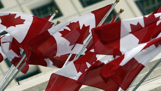 Brand-new Canadian flags wave in the breeze.