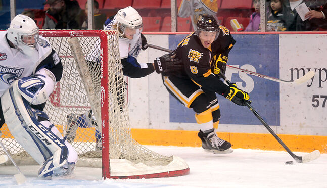 Brandon forward Jayce Hawryluk is pursued behind the net by Swift Current defenceman Brett Lernout while Swift Current goalie Landon Bow keeps an eye on the play during a Nov. 8 game at Westman Place. The Wheat Kings host the Broncos tonight.