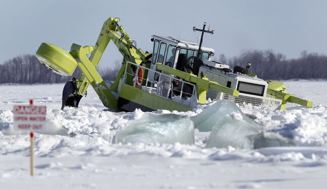 One of three Amphibex ice-breaking machines, out on the Red River north of Selkirk by Netley Creek last week, works on breaking up the ice as part of the province's 2014 ice jam mitigation program.