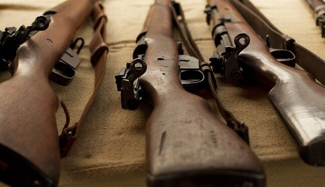 Canadian-made, WWI-era Ross rifles, owned by collector Bob McCormick, are shown at his home in Haldimand, Ont., on Thursday, August 7, 2014. When soldiers in the throes of battle discard their rifles and pluck a different weapon from the hands of dead allies, there's clearly a serious problem. So it was with the Ross rifle, the weapon that Canadian soldiers took with them to the start of the First World War a century ago. THE CANADIAN PRESS/Aaron Lynett