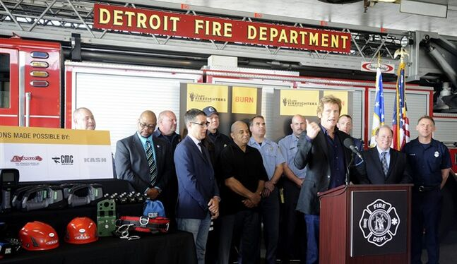 "Actor Denis Leary presents new equipment paid for by proceeds of a documentary film about the city's firefighters, Thursday, May 22, 2014. The film ""Burn"" chronicles the struggles of Detroit firefighters. The donation is being made through the Leary Firefighters Foundation. Leary is a ""Burn"" executive producer and portrayed a firefighter on the TV series ""Rescue Me."" He's to be in Detroit on Thursday to hand out the new gear, including thermal imaging cameras. (AP Photo/The Detroit News, David Coates)"