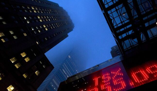 Toronto's financial district is shrouded by fog on December 30, 2011. THE CANADIAN PRESS/Frank Gunn