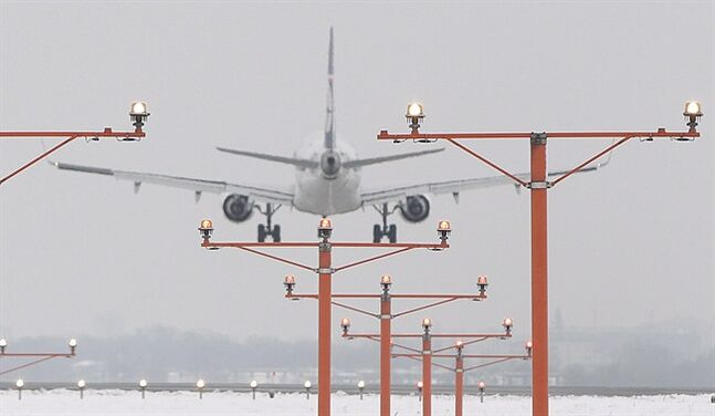 A Boeing 767 of the Polish airlines LOT landing at the Frederic Chopin airport in Warsaw, on Friday, Feb. 22, 2013. THE CANADIAN PRESS/AP, Czarek Sokolowski