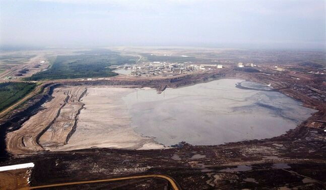 A tailings pond is picture at ythe Syncrude oilsands facility seen from a helicopter near Fort McMurray, Alta., July 10, 2012. THE CANADIAN PRESS/Jeff McIntosh