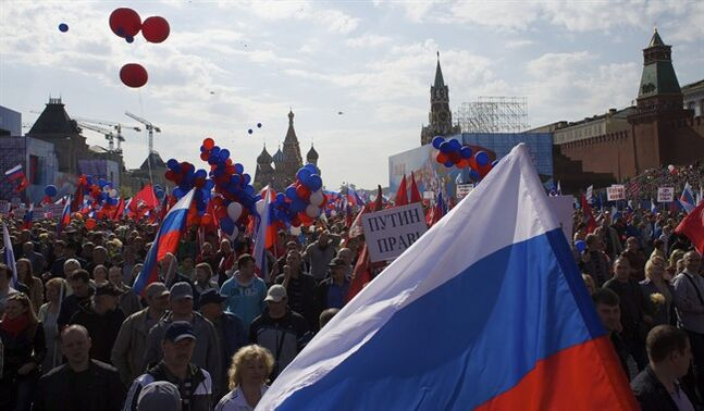 People with Russian flags and posters reading