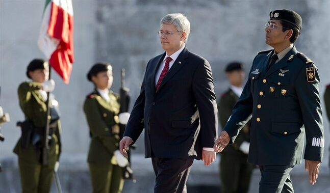 Prime Minister Stephen Harper reviews the honor guard in Mexico City, Monday, Feb. 17, 2014. THE CANADIAN PRESS/AP, Eduardo Verdugo
