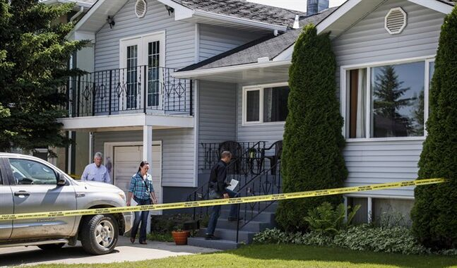 Calgary police investigators check out the home where five-year-old Nathan O'Brien and his grandparents Alvin and Kathryn Liknes disappeared, in Calgary, Alta., Wednesday, July 2, 2014. Police in Calgary say they've made a last sweep of the home owned by a couple who have been missing along with their five-year-old grandson since last month. THE CANADIAN PRESS/Jeff McIntosh