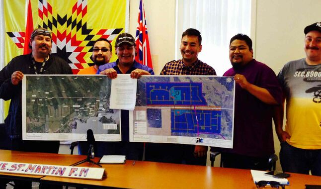 Lake St. Martin First Nation officials show survey maps for the new reserve. The current one was flooded in 2011.