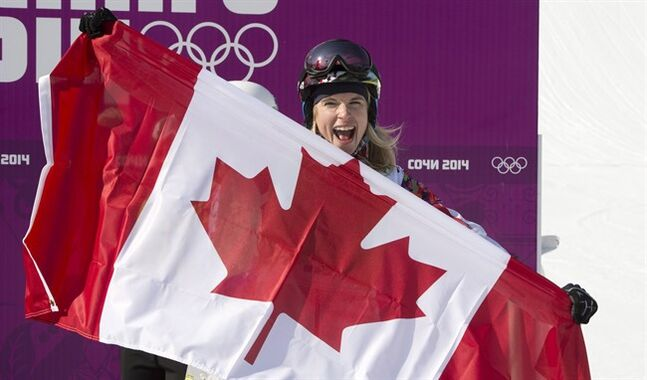 Canada's Dominique Maltais celebrates her silver medal win following the women's snowboard event cross final at the Sochi Winter Olympics in Krasnaya Polyana, Russia, Sunday, Feb. 16, 2014. THE CANADIAN PRESS/Jonathan Hayward