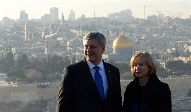 Prime Minister Stephen Harper and wife Laureen visit Mount of Olives in Jerusalem, Israel, Sunday. Dome of the Rock in the Old City of Jerusalem is seen in the background. While in the Middle East Harper will be visiting Israel, West Bank and Jordan.