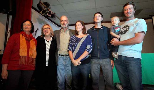 Green Party of Canada Leader Elizabeth May (second from left) is all smiles as she is surrounded by David Neufeld (third from left) and his family. Neufeld will carry the Green banner into the upcoming Brandon-Souris federal byelection after winning the nomination last night.