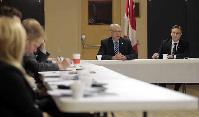 Brandon-Souris Conservative MP Larry Maguire and Ontario MP Peter Braid, parliamentary secretary to the minister of infrastructure and communities, meet with civic leaders to discuss the New Building Canada Fund at the East End Community Centre on Thursday.