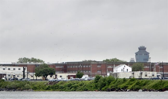FILE - In this May 17, 2011 file photo, a section of the Rikers Island prison is seen in New York. In September 2013, a mentally ill New York City inmate named Bradley Ballard died after he was found in his Rikers Island cell naked and covered in feces, with a rubber band tied around his badly infected genitals, after being locked alone in his cell for seven days. Documents obtained by The Associated Press show 39-year-old Bradley Ballard was checked on dozens of times in his cell in September before he was rushed to a hospital. (AP Photo/Seth Wenig, File)