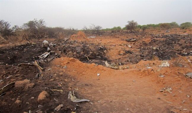 This photo provided on Friday, July 25, 2014, by the Burkina Faso Military shows the site of the plane crash in Mali. French soldiers secured a black box from the Air Algerie wreckage site in a desolate region of restive northern Mali on Friday, the French president said. Terrorism hasn't been ruled out as a cause, although officials say the most likely reason for the catastrophe that killed all onboard is bad weather. At least 116 people were killed in Thursday's disaster, nearly half of whom were French. (AP Photo/Burkina Faso Military)