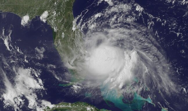 This Tuesday, July 1, 2014, satellite image released by the National Oceanic and Atmospheric Administration (NOAA), shows the center of Tropical Storm Arthur off the east coast of Florida. With the July Fourth weekend on the horizon, the Atlantic hurricane season's first named storm plodded off Florida's coast early Wednesday, though Tropical Storm Arthur wasn't yet spooking too many in the storm's potential path. (AP Photo/NOAA)