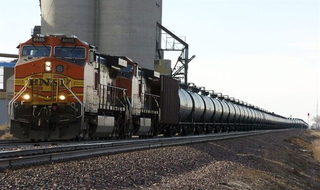 FILE - In this Nov. 6, 2013, file photo, a BNSF Railway train hauls crude oil near Wolf Point, Mont. The U.S. Department of Transportation ordered railroads last month to give state officials specifics on oil train routes and volumes so emergency responders can better prepare for accidents. North Dakota's State Emergency Response Commission unanimously voted to release the state's information Wednesday June 25, 2014. (AP Photo/Matthew Brown, File)