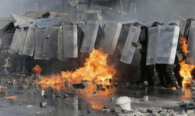 Riot police clash with anti-government protesters outside Ukraine's parliament in Kiev, Ukraine, Tuesday, Feb. 18, 2014. Some thousands of anti-government protesters clashed with police in a new eruption of violence Tuesday. (AP Photo/Efrem Lukatsky)