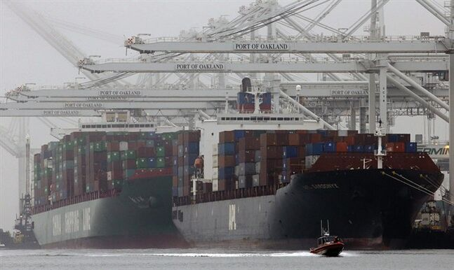 FILE - In this Wednesday, Oct. 23, 2013, file photo, container ships wait to be off-loaded in a thick fog at the Port of Oakland in Oakland, Calif. The Commerce Department releases fourth-quarter gross domestic product on Friday, Feb. 28, 2014. (AP Photo/Ben Margot, File)