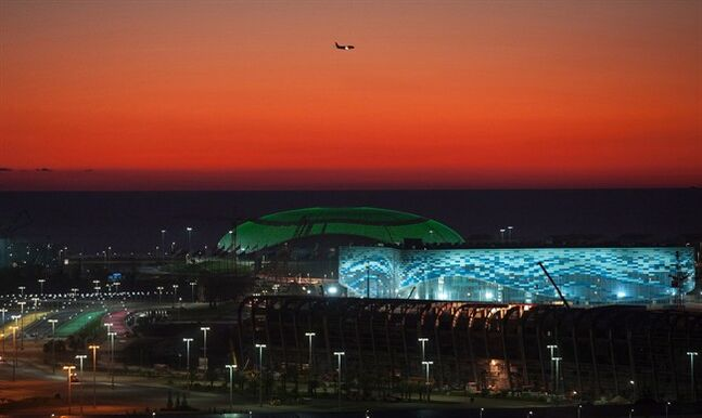 In this Oct. 24, 2013 photo the Olympic Bolshoy stadium, in the background, and Iceberg stadium are illuminated in the Olympic park in Sochi, Russia. THE CANADIAN PRESS/AP, Lesya Polyakova