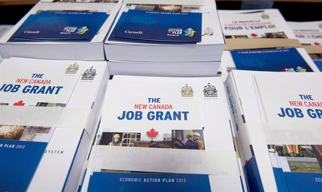 Copies of the Federal Budget are pilled on a desk with New Canada Job Grant pamphlets attached in Ottawa on Thursday March 21, 2013. THE CANADIAN PRESS/Adrian Wyld