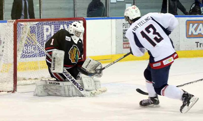 Neepawa goalie Matt Kohlman of McCreary stops Brandonite Mitch Van Teeling of the Dauphin Kings Sunday at the Yellowhead Centre.