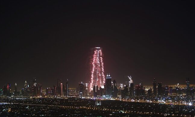 Fireworks errupt from the Burj Khalifa, world's tallest building, at midnight to celebrate the New Year, Wednesday, Jan. 1, 2014, in Dubai, United Arab Emirates. (AP Photo/Kamran Jebreili)