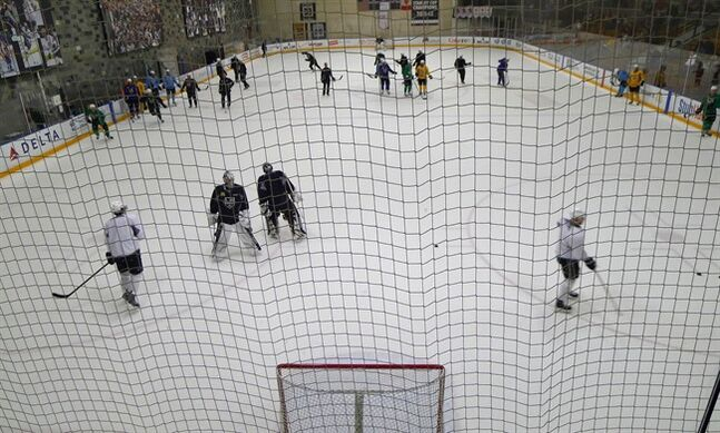 Kings' players are seen on the ice during practice at the Kings' facility in El Segundo, Calif., on Friday, June 6, 2014. THE CANADIAN PRESS/Neil Davidson