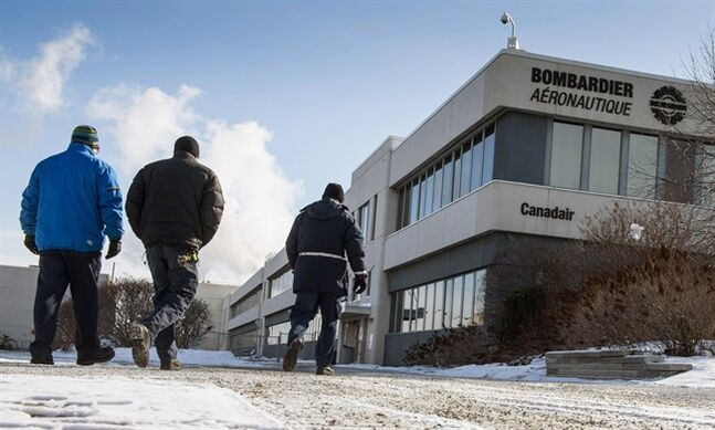 Employees arrive at the Bombardier plant, Tuesday, January 21, 2014 in Montreal. Bombardier announced 1,700 layoffs, 1, 100 of which are in Quebec. THE CANADIAN PRESS/Paul Chiasson