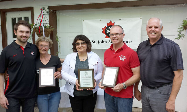(L-R): Peter Quenneville representing the Brandon Wheat Kings, Debra Roskam, Laura Struthers, Steven Damery, and Keith Atkinson, vice-chair of the board of directors for St. John Ambulance Manitoba Council. Missing from the photo is Jordyn Maduke.