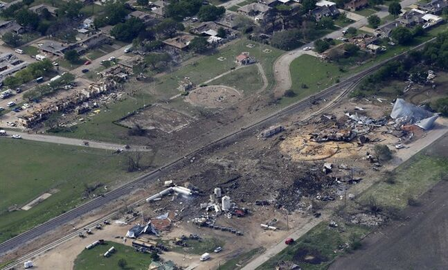 FILE - This April 18, 2013 file photo shows an aerial view of the remains of a fertilizer plant and an apartment complex to the left, destroyed by an explosion in West, Texas. The government has no way of fully knowing which U.S. chemical facilities stock ammonium nitrate that poses an explosion risk, congressional investigators say. Outdated federal policies, poor information sharing with states and a raft of industry exemptions point to scant federal oversight. (AP Photo/Tony Gutierrez, File)